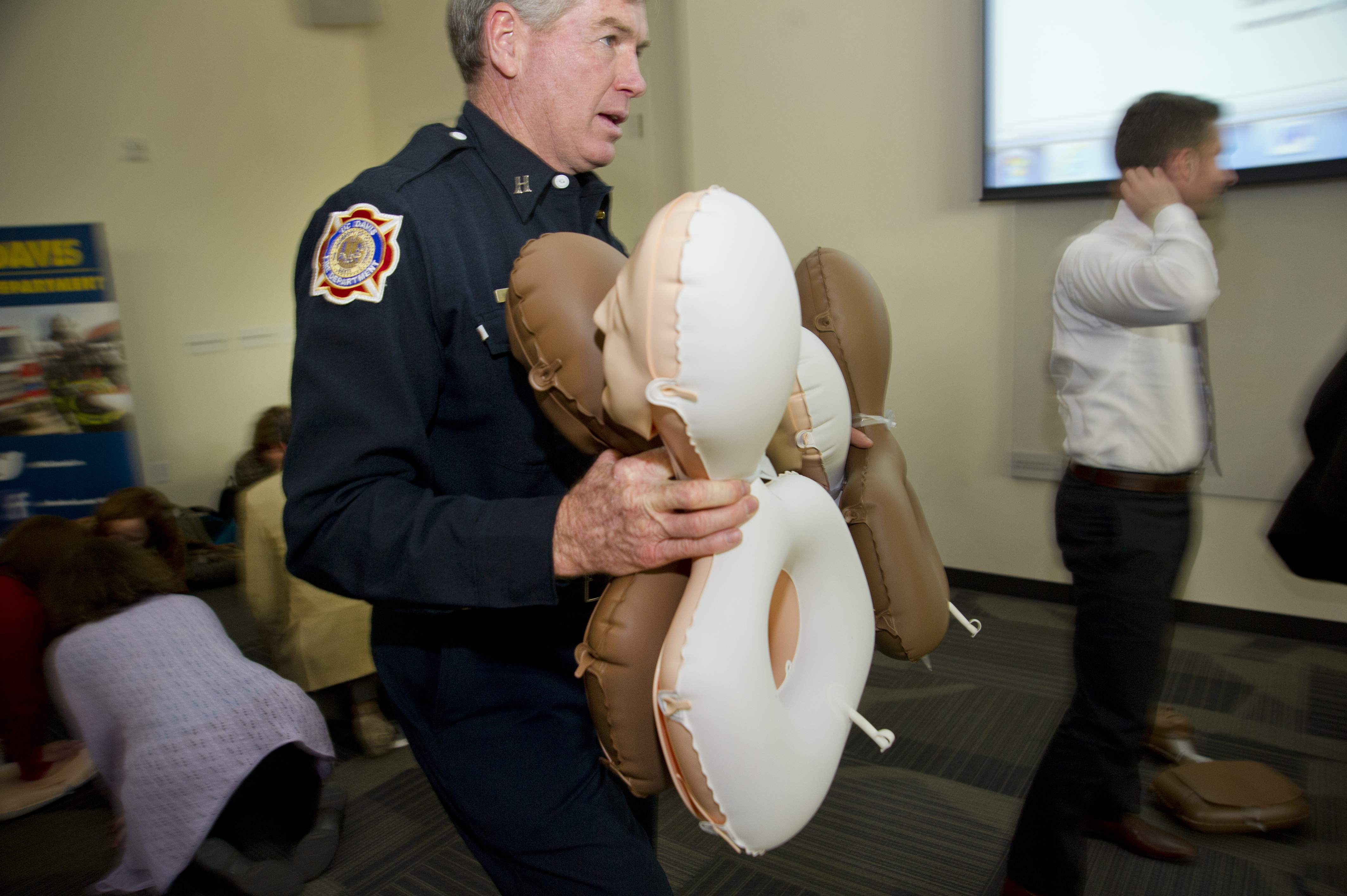 """UC Davis Firefighter with CPR supplies"""