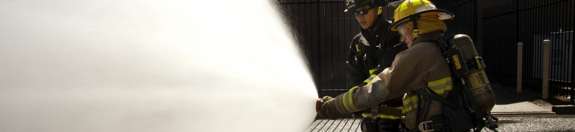 Learning how to use a fire hose.